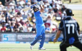India's Rohit Sharma takes the attack to the New Zealand bowlers.