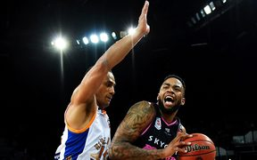 Mika Vukona guards Breakers US import Shawn Long
