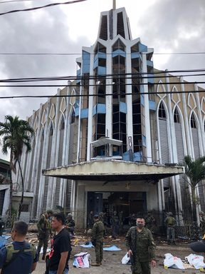 Armed Forces of the Philippines photo shows soldiers in front of a Catholic Church where two bombs exploded in Jolo, Sulu province on the southern island of Mindanao.