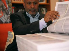The chairman of the United Liberation Movement for West Papua, Benny Wenda, peruses the petition calling for West Papuan decolonisation.