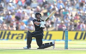 Ross Taylor watches the ball as it goes for 4 runs.