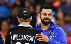 India's captain Virat Kohli shakes hands with Kane Williamson after another win for India.
