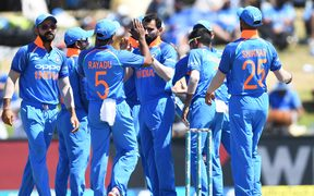India players celebrate a Black Caps  wicket.