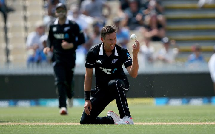 New Zealand's Trent Boult takes a caught and bowled to dismiss India's Rohit Sharma during the 4th One Day International cricket match.