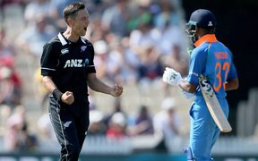 Trent Boult dismisses India's Hardik Pandya to pick up his 5th wicket during the 4th One Day International cricket match.