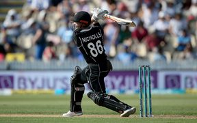 New Zealand's Henry Nicholls hits a boundary during the 4th One Day International cricket match against India.