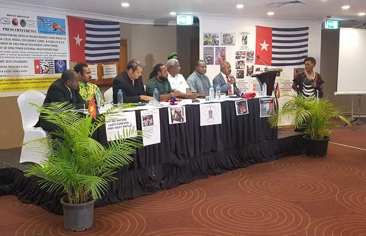 Governor of Papua New Guinea's National Capital Powes Parkop (with mic) speaks at OPM (Free Papua Movement) press conference in Port Moresby 31 January 2019