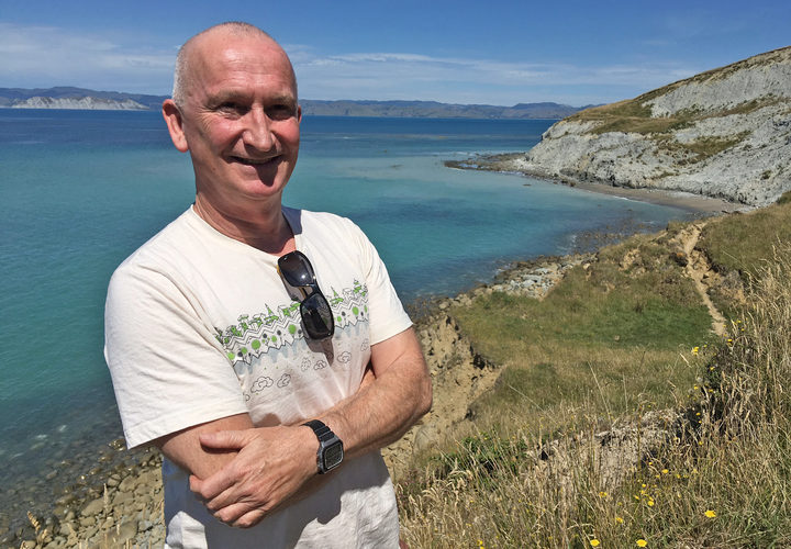 Martin Williams stands on the hill above Sponge Bay, Gisborne, where he was hit