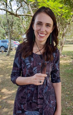 Jacinda Ardern with the gift of a 1400-year-old wooden pendant