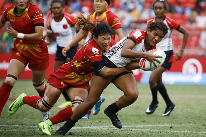 PNG's Helen Abau is tackled by China's Wang YueYue in the 11th place playoff.