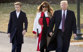 President Donald Trump accompanied by first lady Melania Trump, and their son Barron