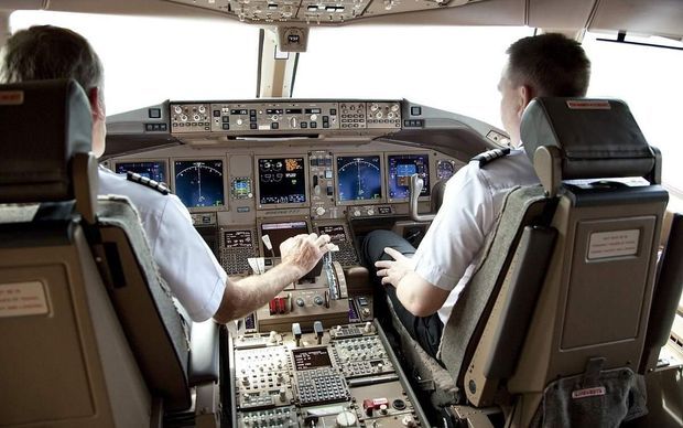 Pilots on flight deck of Air NZ Boeing 777-300ER .