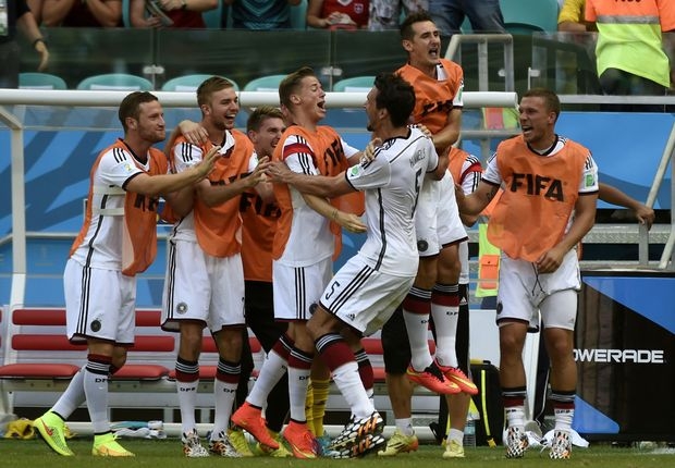 German players celebrate Mats Hummels goal during the Group G football match against Portugal at the Fonte Nova Arena in Salvador, Brazil.
