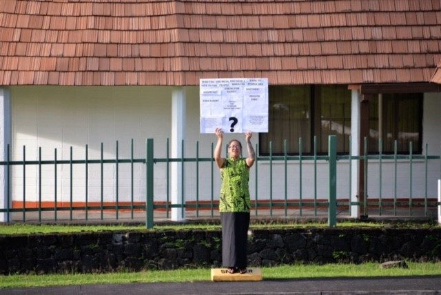 Moira Maiava holding her one woman protest for better health care in American Samoa