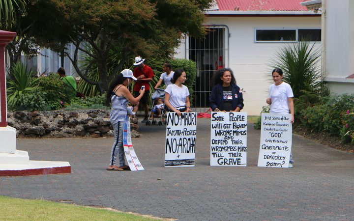 Three women were protesting inside Te Tii grounds.