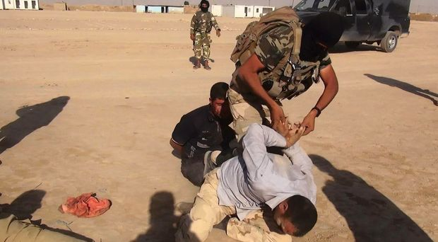 An image made available by the jihadist Twitter account Al-Baraka news  allegedly shows Islamic State of Iraq and Syria militants (ISIS) restraining an unidentified man at an undisclosed location close to the Iraqi-Syrian border, in the district of Sinjar, northwest Iraq.