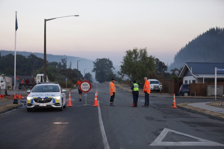 Emergency services guard a cordon in Wakefield township, where residents have been asked to be prepared to leave at a moment's notice.