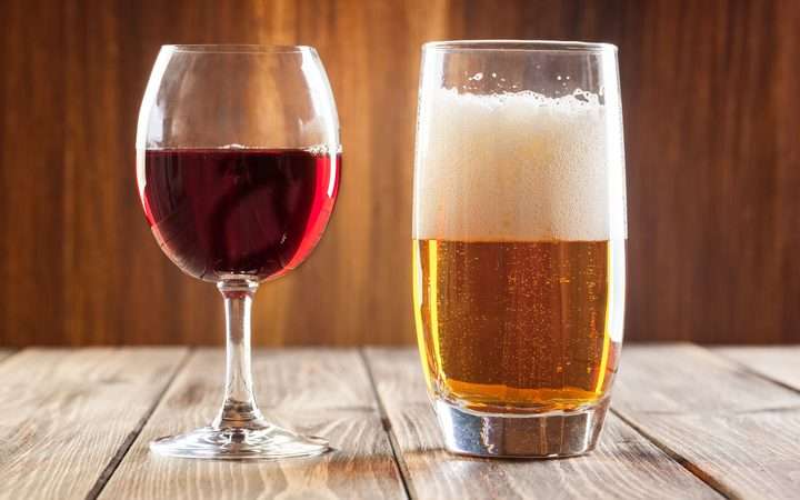 Glass of red wine and glass of light beer