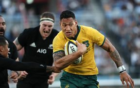 The Wallabies back Israel Folau in action against the All Blacks.