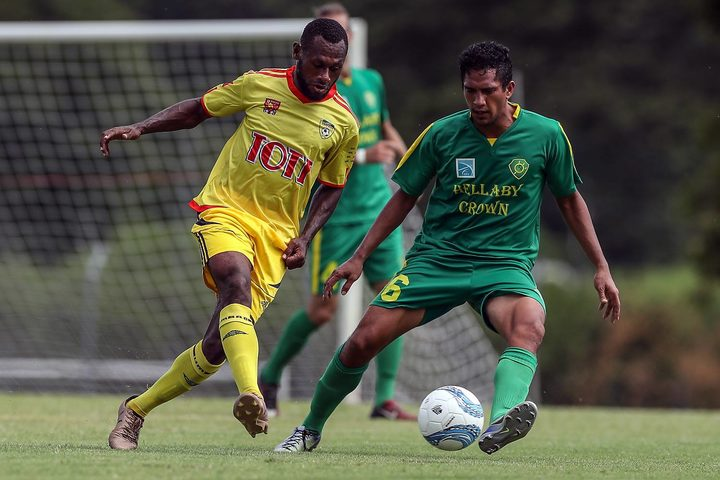Nigel Dabinyaba (L) scored twice as the PNG champions fought back to earn a draw.