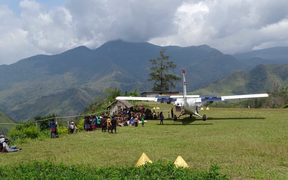 Mission Aviation fellowship aircraft at a rural airstrip in Ande, Papua New Guinea.