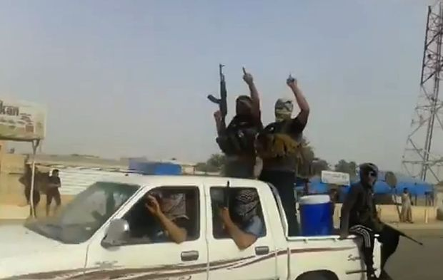 An image taken from a video uploaded on Youtube allegedly shows militants from the Islamic State of Iraq and Syria (ISIs) parading  in the northern city of Baiji.