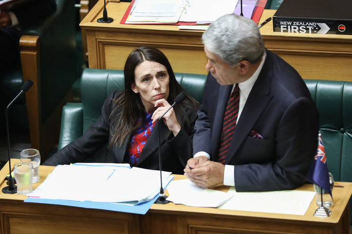 Jacinda Ardern listening to Winston Peters asking a supplementary question