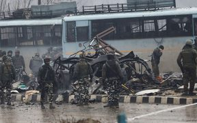 Indian security forces inspect the remains of a vehicle following an attack on a paramilitary Central Reserve Police Force (CRPF) convoy that killed at least 40 troopers and injured several others near Awantipur town in the Lethpora area of Kashmir about 30km south of Srinagar on February 14, 2019.