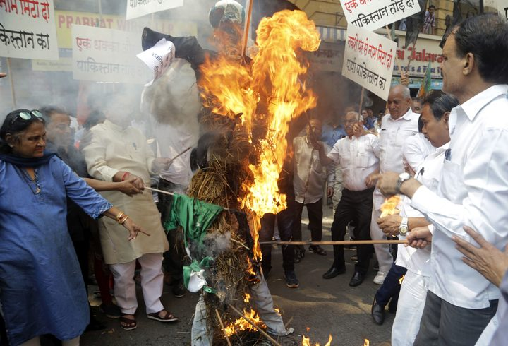 India's ruling Bharatiya Janata Party workers burn a symbolic effigy of Pakistan as part of protest against Thursday's attack on a paramilitary convoy in Kashmir.
