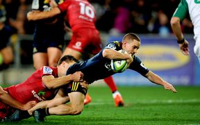 Kayne Hammington of the Highlanders dives for a try during the Super Rugby match against the Reds at Forsyth Barr Stadium.