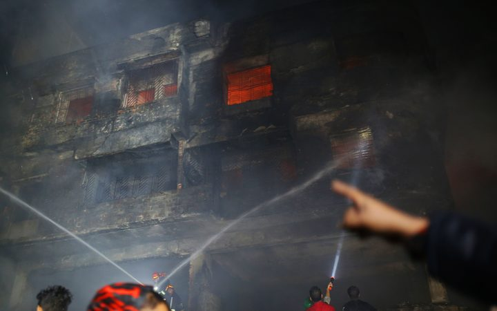 Fire-fighters try to control fire at Chawkbazar, old part of Dhaka city, Bangladesh on February 21, 2019.