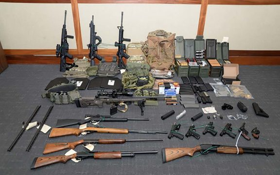 This undated image released by the US Attorney's Office on February 20, 2019, shows weapons seized at the Silver Spring, Maryland, home of US Coast Guard officer Christopher Paul Hasson.