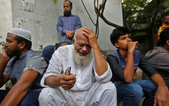 A relative of victims who were killed in a fire mourns in Dhaka on February 21, 2019.