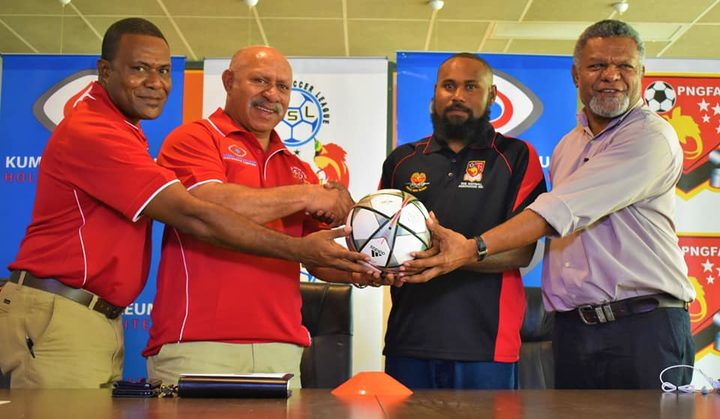 PNGFA President John Kapi Natto (2L) and   Tonga Esira (2R) at the launch of the National Soccer League's New Guinea Islands Conference.