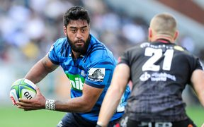 Akira Ioane of the Blues runs at the defence of Cameron Wright