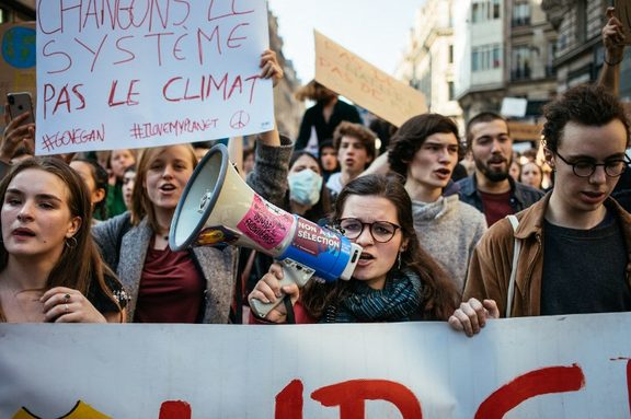 Strike against climate change. Fridays for the climate. Youth march with Greta Thunberg in support of the French students. Girl with megaphone. Paris, February 22, 2019.