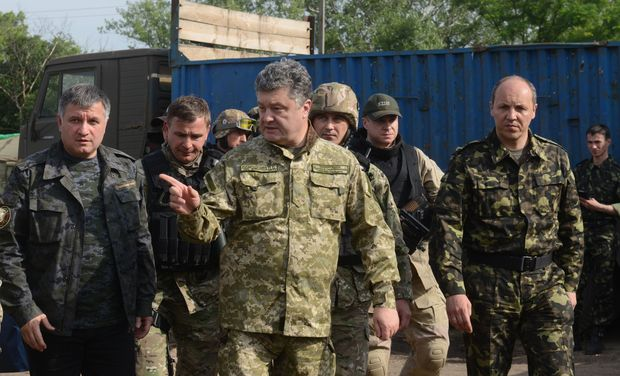 Ukrainian President Petro Poroshenko wearing military fatigues speaks with Ukrainian army's Anti-Terrorist officers.