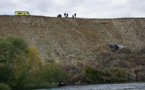 Emergency services look over the scene of a fatal jet boat crash on the Clutha River below Wanaka Airport 24 February 2019.