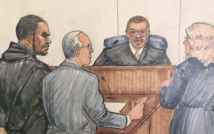 In this courtroom sketch R&B singer R Kelly attorney Steve Greenberg and prosecutor Jennifer Gonzalez appears before Cook County Judge John Fitzgerald Lyke Jr. at the Leighton Criminal Courthouse