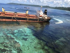 The MV Solomon Trader stuck on a reef off of Rennell Island in the Solomon Islands.