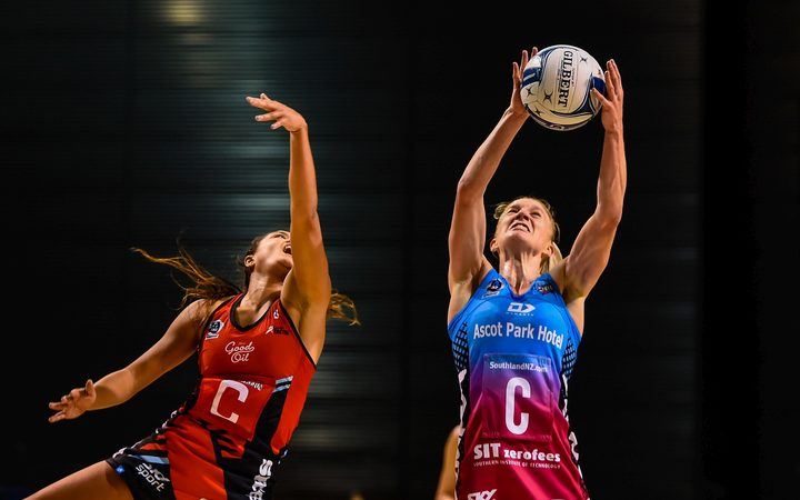 Shannon Saunders of the Steel takes a ball from Kimiora Poi of the Tactix.