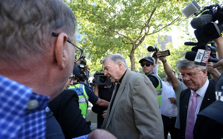 Cardinal George Pell makes his way through media as he arrives at court in Melbourne on 27 February 2019 for a sentence plea hearing.