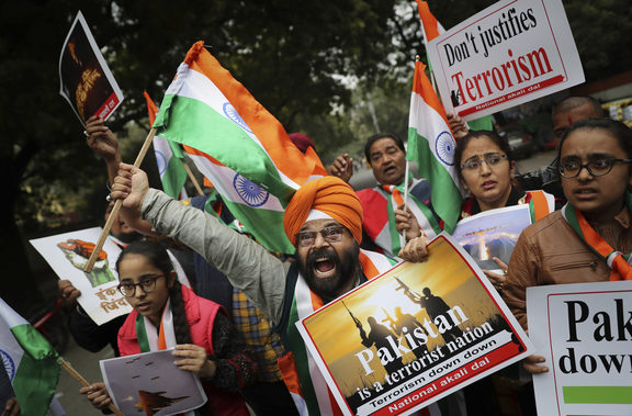A National Akali Dal leader shouts slogans in support of India and against Pakistan as he celebrates reports of Indian aircrafts bombing Pakistan territory, in New Delhi, India.