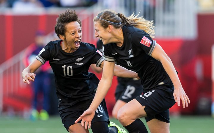 Rebekah Stott (right) and Sarah Gregorius celebrate a goal against China in 2015.