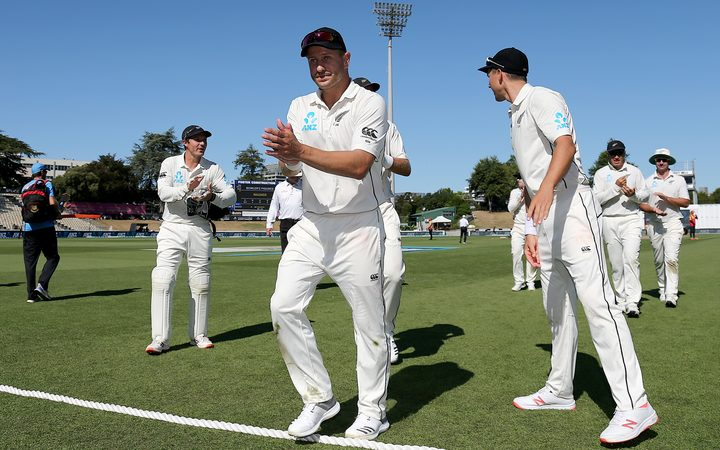 New Zealand's Neil Wagner is clapped off the field by team mates after taking his sixth five wicket bag in test cricket.