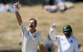 Neil Wagner celebrates picking up the wicket of Bangladesh's Mominul Haque.