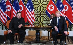 US President Donald Trump (R) and North Korea's leader Kim Jong Un hold a meeting during the second US-North Korea summit at the Sofitel Legend Metropole hotel in Hanoi on February 28, 2019.