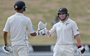 Black Caps Jeet Raval and Tom Latham celebrate their 100 run opening partnership on Day 2 of the first cricket Test against Bangladesh.
