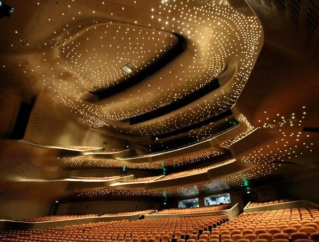 Guangzhou Opera House's asymmetrical auditorium lined with moulded panels to reflect sound devised by MarshallDay