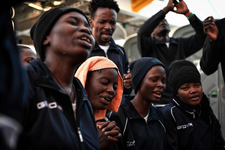 Christian migrants pray aboard the rescue ship MV Aquarius near the coast of Malta last year, heading to the Italian port of Messina.